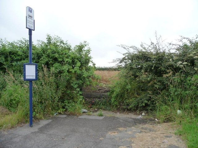 Bus stop at a blocked field entrance