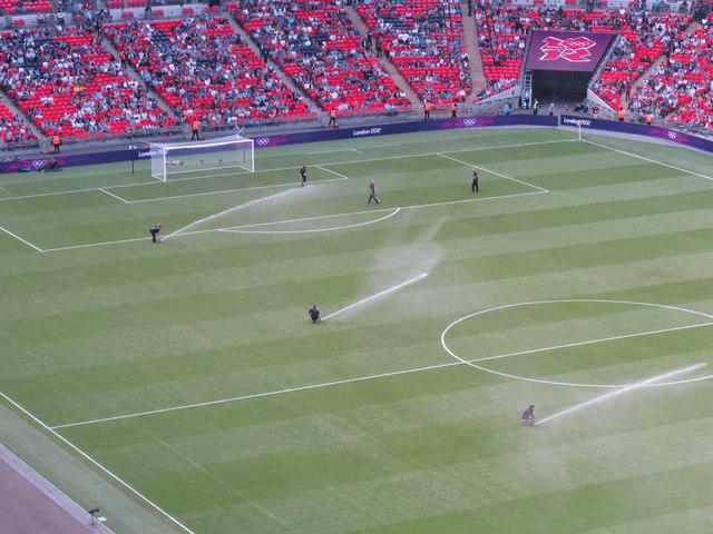 Ground staff water the pitch, Wembley Stadium