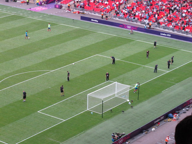 Half time at Wembley, ground staff manicure the pitch