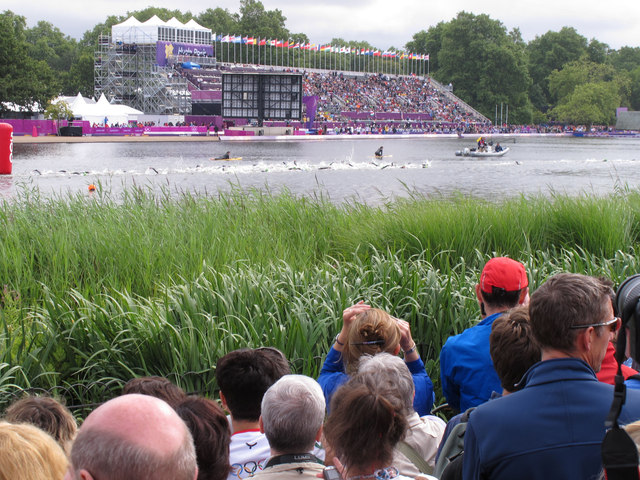 Olympics triathlon Hyde Park - swimmers return past the grandstand