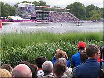 TQ2780 : Olympics triathlon Hyde Park - swimmers return past the grandstand by David Hawgood