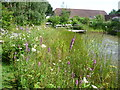 TQ7559 : The pond and barn at Tyland Barn by Marathon