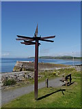 NX3343 : Millennium Signpost And The Quay At Port William by James T M Towill