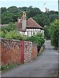 TL7835 : Looking up Castle Lane , Castle Hedingham, Essex by Derek Voller