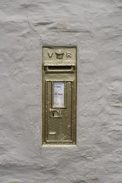 Golden postbox in the wall of the Pandora Inn
