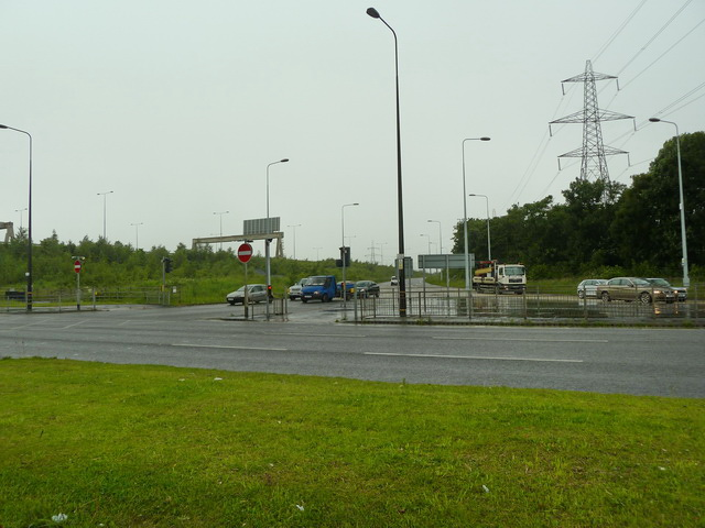 End of the slip road off the M60 at its junction with the A56