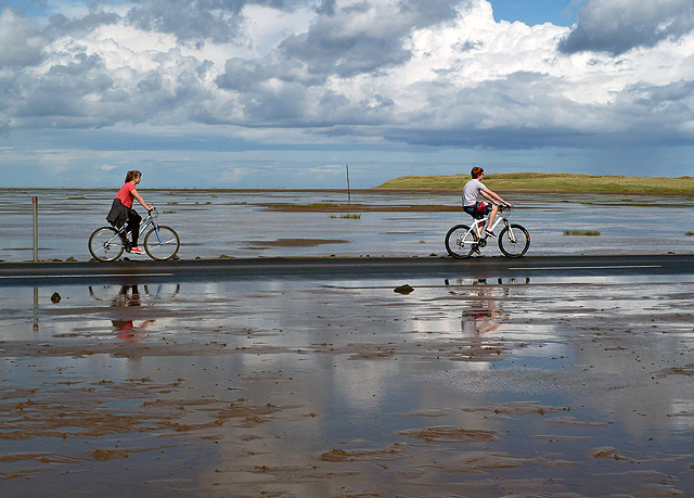 Cyclists on Lindisfarne Causeway
