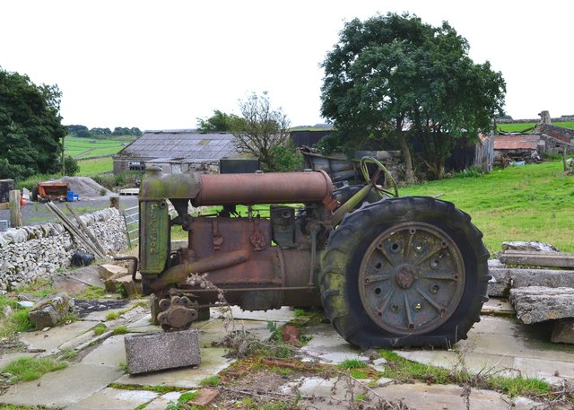 Old tractor at a farm entrance in Coplow Dale