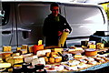 R3377 : Ennis - Market Place - Varieties of Cheese for Sale at Farmers' Market by Suzanne Mischyshyn