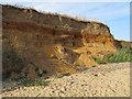 TM0614 : Gravel strata in cliffs by Roger Jones