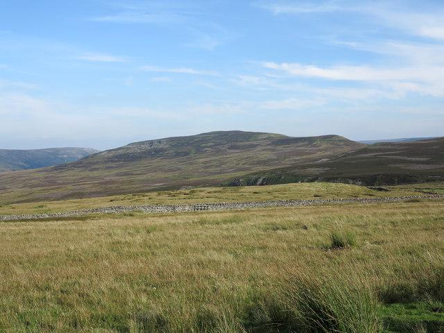 Calver Hill over moor from minor road on Turf Moor by Trevor Littlewood
