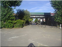 TQ2472 : Railway bridge over the entrance to Wimbledon Park car park by David Howard