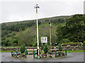 SD9772 : The maypole at Kettlewell by Richard Green