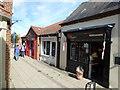 TF0920 : Shops in Crown Walk by Bob Harvey