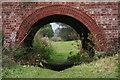 SE8628 : Brick is beautiful: railway bridge over footpath by Chris