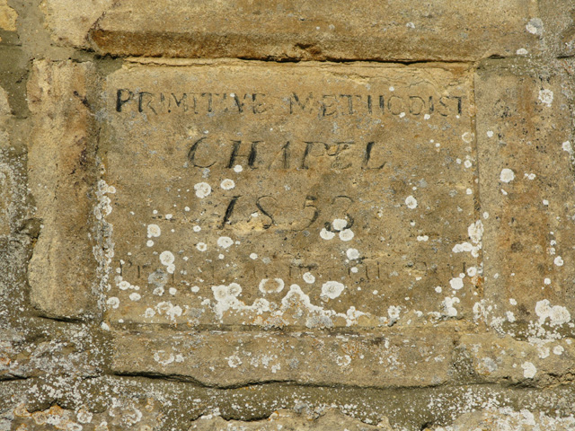 Stone in the wall of a chapel in Filkins
