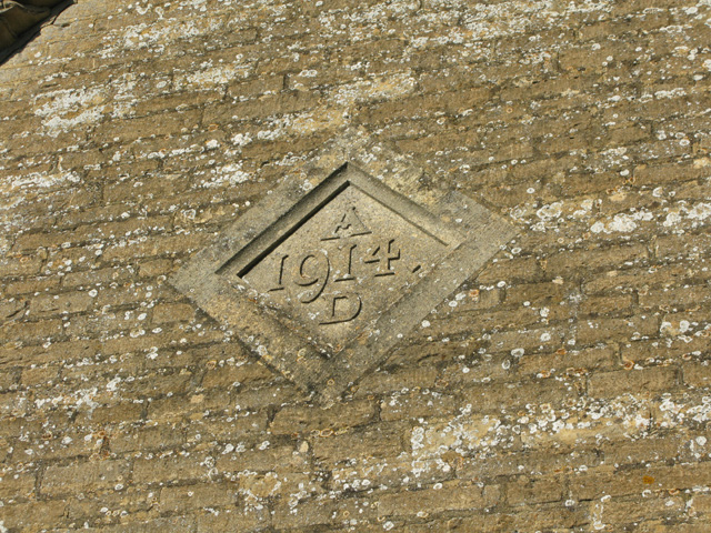 Date stone in the wall of the village hall