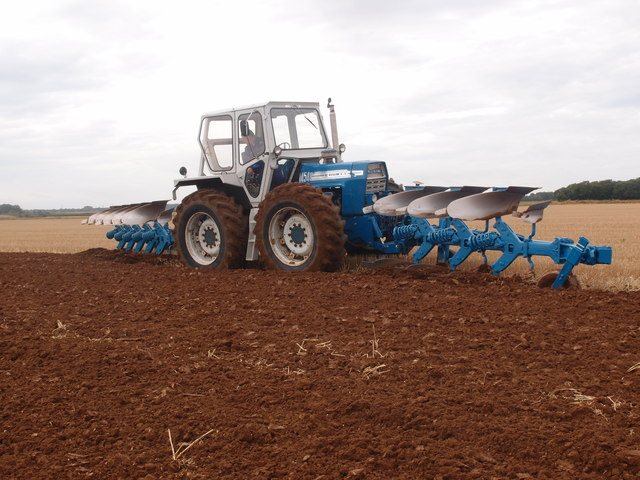 County tractor with front and rear ploughs