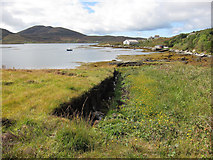 NF7828 : Cut peat by Loch Aineort by Hugh Venables