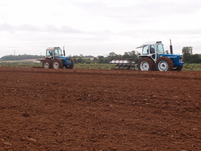 County tractors ploughing