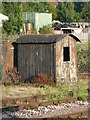 SO8555 : Tin shed by the railway by Chris Allen