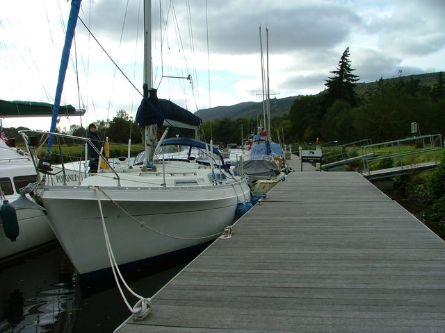 Boats moored at Dochgarroch by Dave Fergusson