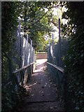 TQ7668 : Bridge over Chatham Lines leading to Officers Tennis Club, Brompton (2) by David Anstiss