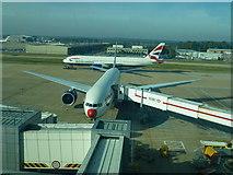 TQ2741 : British Airways planes near stand 57 by Richard Humphrey