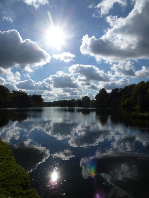 Stourhead: view across the lake into the sun