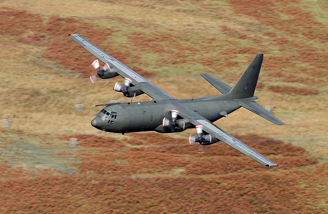 A Hercules flying low over St Mary's Loch