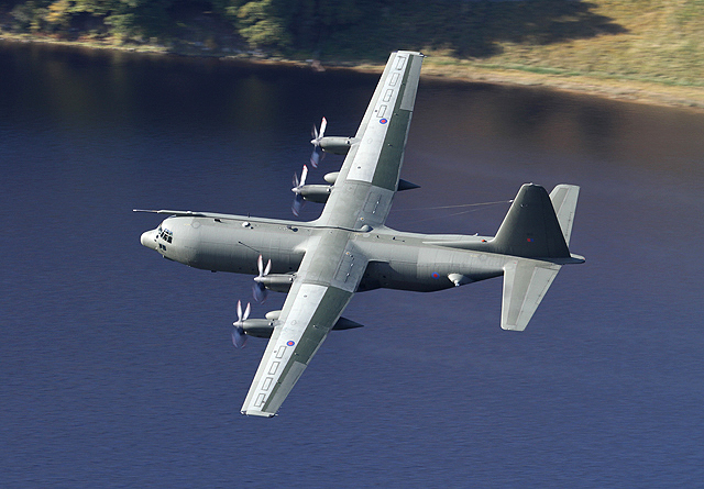 A low flying Hercules aircraft over St Mary's Loch