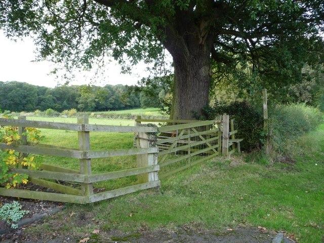 Footpath stile and padlocked gate