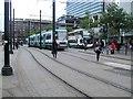 SJ8498 : Tram & Bus - Piccadilly Gardens by Paul Gillett