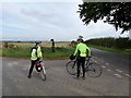 TF1595 : Cyclists pause at a junction on the National Cycle Network by Oliver Dixon
