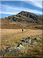 NY2201 : Crossing the Roman parade ground above Hardknott fort by Karl and Ali