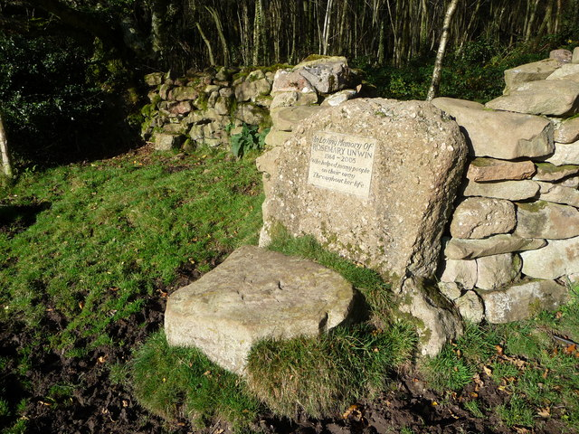 Memorial stile into scrub woodland on Gray Hill