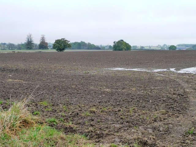 Flooding on the south side of a ploughed field