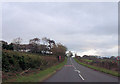 SH3837 : Straight road just south of Hospital by John Firth