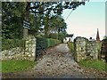 NX8666 : The entrance to Kirkgunzeon Church by Ann Cook