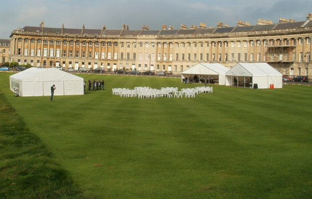 White marquees and white chairs on the lawn in front of Royal Crescent, Bath