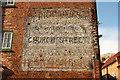 SK7953 : Painted advertisement on Boar Lane by Richard Croft