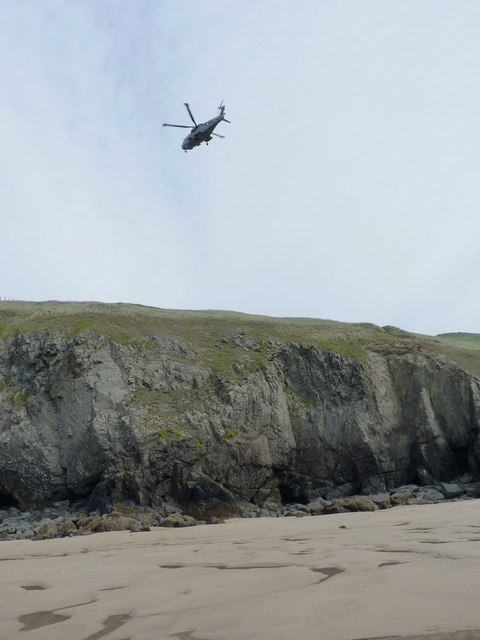 Sea King helicopter above the cliffs