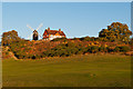 TQ2349 : Reigate Heath Windmill and Reigate Heath Golf Club clubhouse by Ian Capper