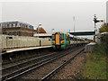 TQ5804 : Polegate station - eastbound train by Stephen Craven
