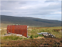NY6740 : Hut or shed beside Maiden Way by Trevor Littlewood
