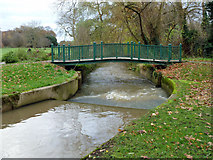 TQ2992 : Weir and footbridge, Pymme's Brook by Robin Webster