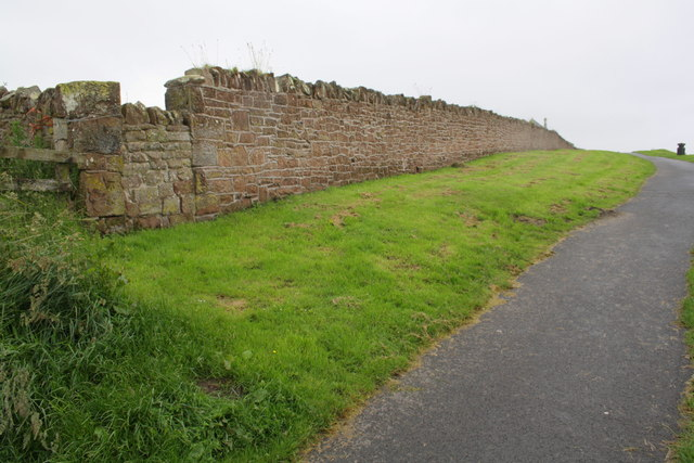 Wall beside coastal path north of the Battery by Roger Templeman