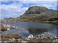 NG8744 : Lochan west of summit of Sgùrr a' Gharaidh by Trevor Littlewood