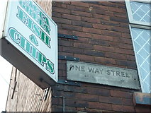 SE5023 : Knottingley: old One-Way Street sign in Racca Green by Chris Downer