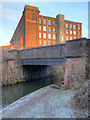 SJ9297 : Ashton Canal, Bridge#25 and Guide Bridge Mill by David Dixon
